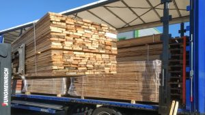 Loading A Truck With Reclaimed Wood Boards Shipping International